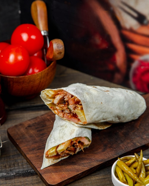 Chicken doner in lavash on wooden board Free Photo
