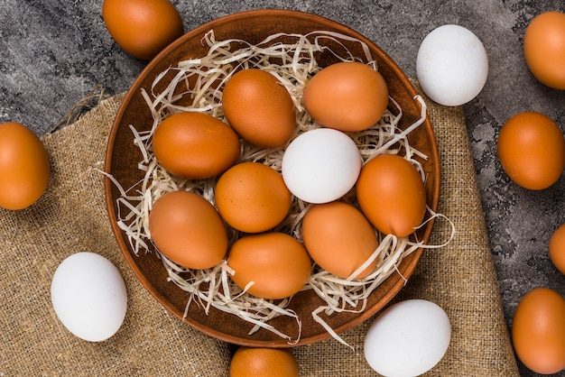 Chicken eggs in bowl on canvas Free Photo