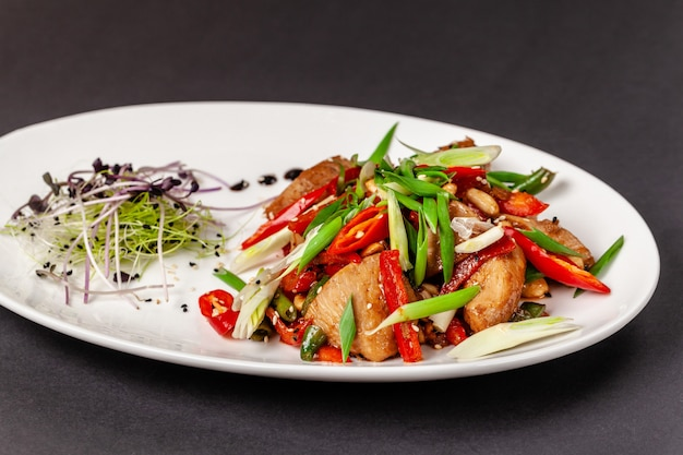 Chicken fillet marinated in japanese soy sauce with fresh vegetables Premium Photo