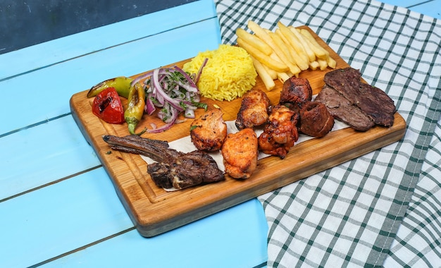 Chicken and meat barbecue with rice and vegetable salad Free Photo