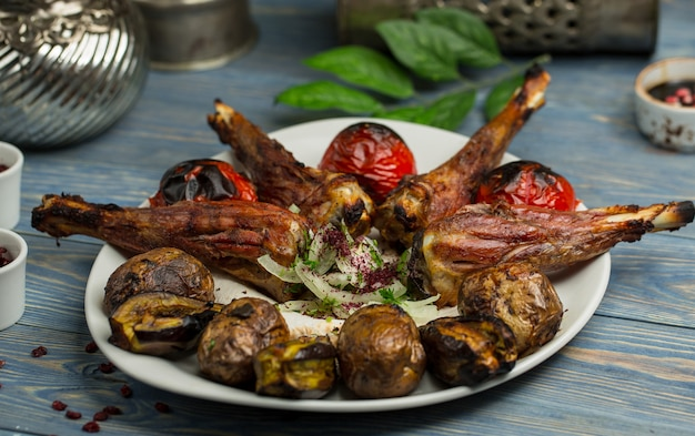 Chicken nugget kebab with grilled potatoes and tomatoes. Free Photo