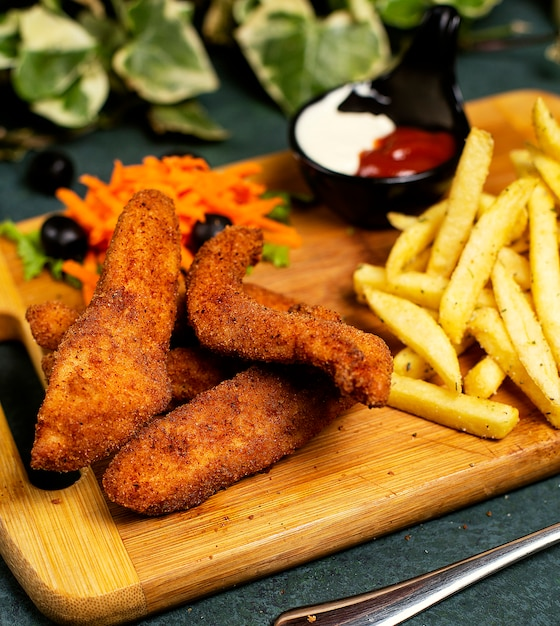 Chicken nuggets kfc style with french fries, mayonnaise, ketchup and vegetable salad Free Photo
