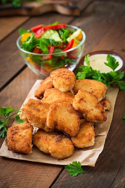 Chicken nuggets and sauce Premium Photo
