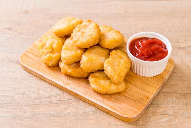 Chicken nuggets with sauce Premium Photo