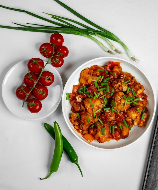 Chicken pieces with tomatoes and herbs Free Photo