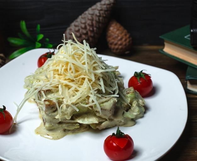 Chicken salad in cream sauce and grated cheese Free Photo