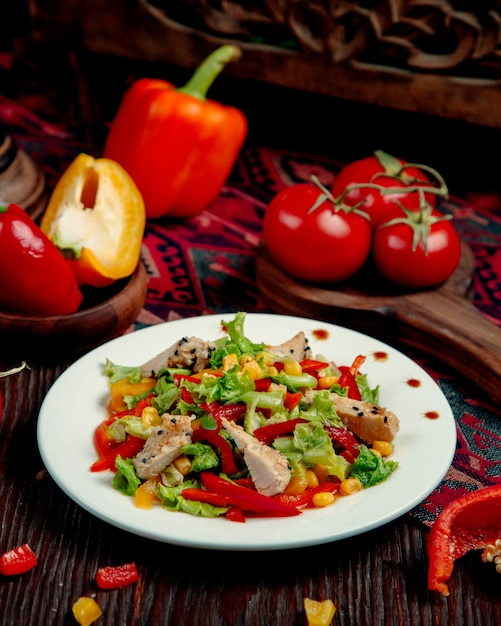 Chicken salad with corn pepper and lettuce Free Photo