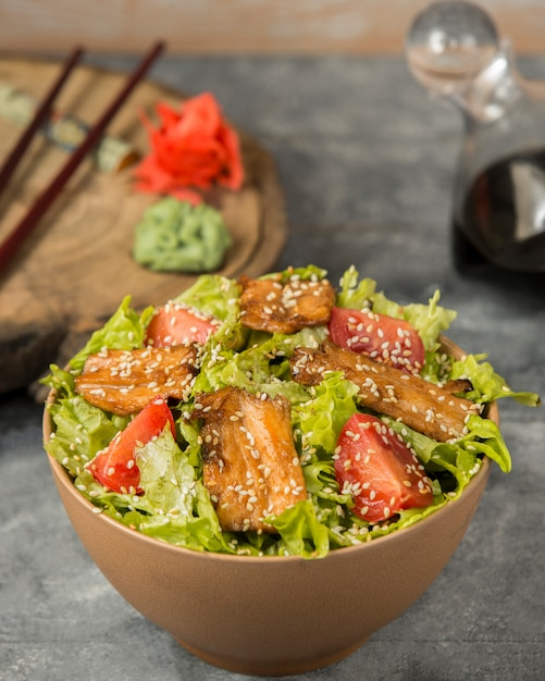 Chicken salad with sesame on the table Free Photo