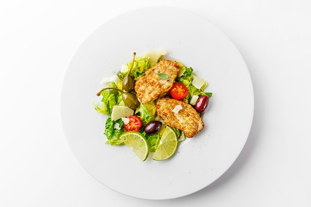 Chicken salad with vegetables and olives Free Photo