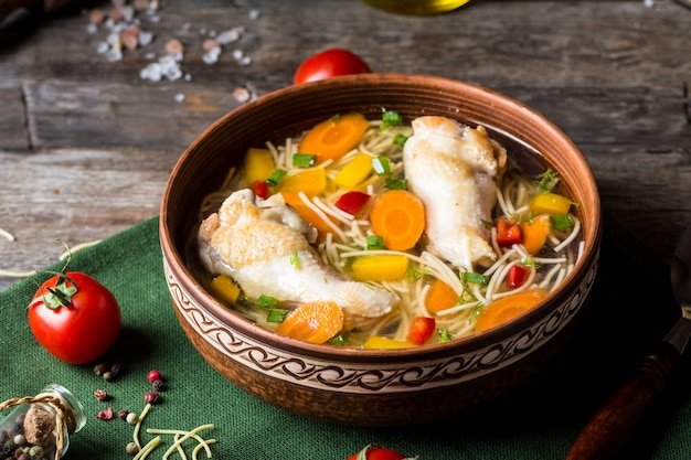 Chicken soup with vegetables. healthy food. traditional dish. carrot dish. pasta soup. minestrone soup Premium Photo