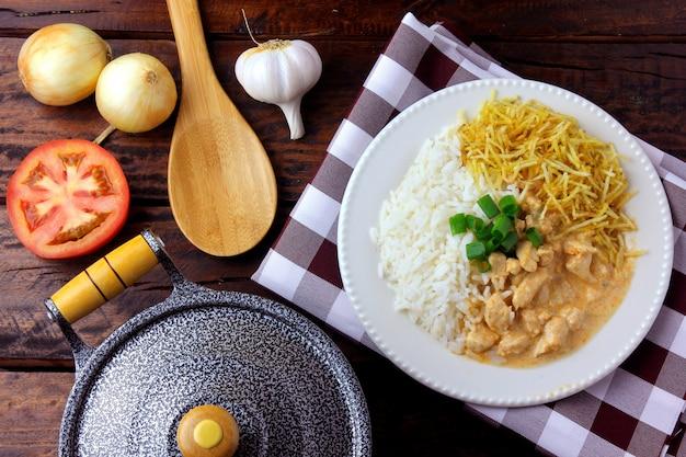 Chicken stroganoff, pan and ingredients. Premium Photo