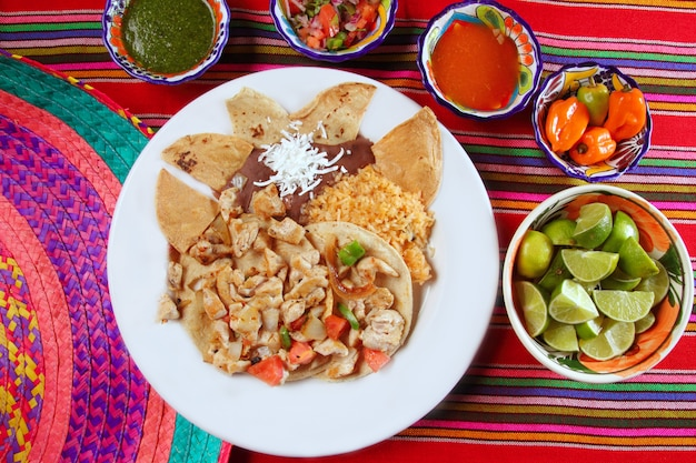 Chicken tacos mexican style chili sauce and nachos Premium Photo