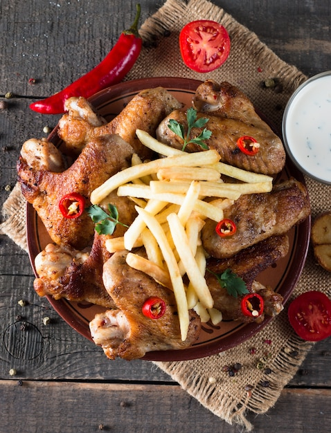 Chicken wings with fries Premium Photo