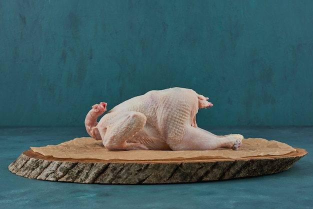 Chicken on a wooden board. Free Photo
