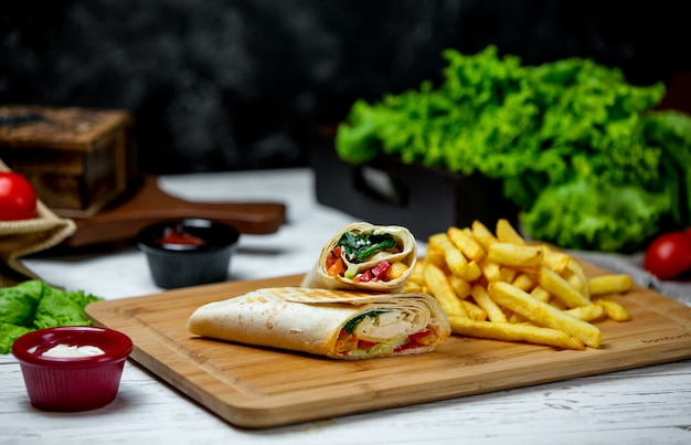 Chicken wrap with side french fries Free Photo
