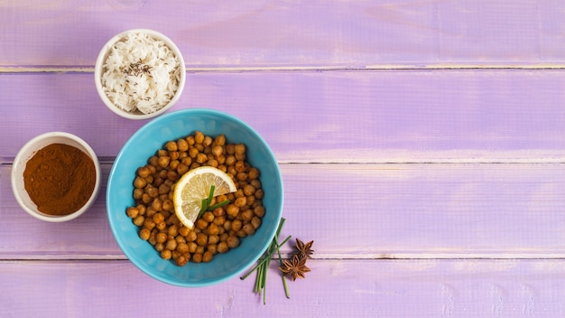 Chickpea and rice near spices Free Photo