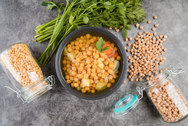 Chickpeas homemade soup and jars Free Photo