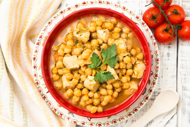 Chickpeas with turkey meat, pepper, carrots and greens. Premium Photo