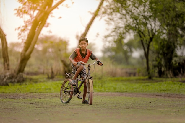 Child on bicycle Premium Photo