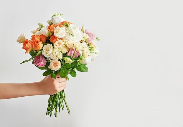 Child boy with bouquet of flowers. Premium Photo