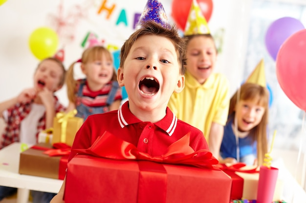 Child celebrating his birthday Free Photo
