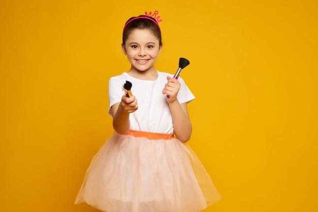 Child cheerful stylish kid in pink skirt. Premium Photo