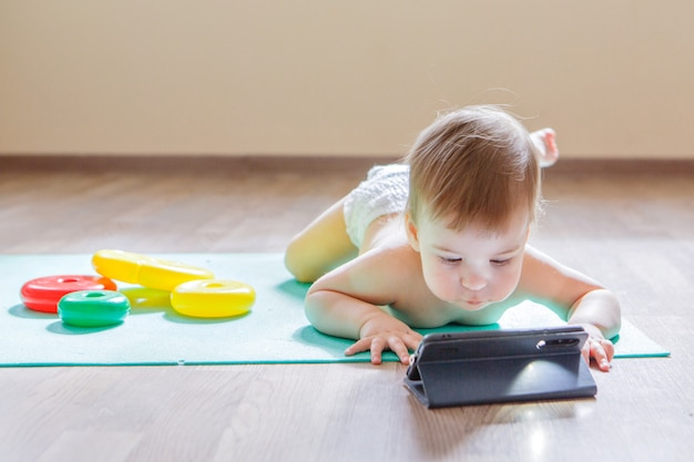 Premium Photo Child Chose To Play With Phone Instead Of Toys Girl Is Watching Cartoon Toys Are Lying Around Concept Of Advertising Of Equipment Phones Educational Games Childhood Children S Day Kindergarten