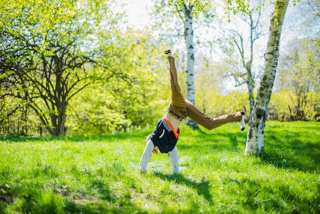 Child doing pirouettes in the grass Free Photo