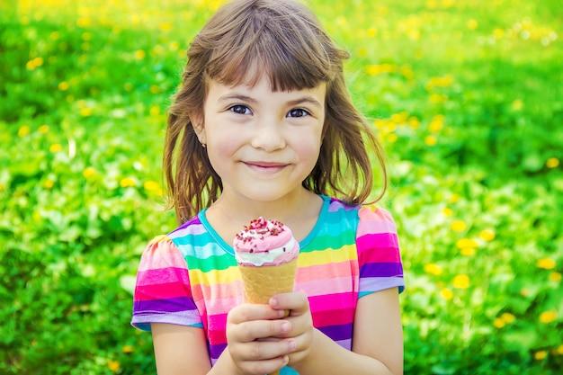 The child eats ice cream. selective focus. Premium Photo
