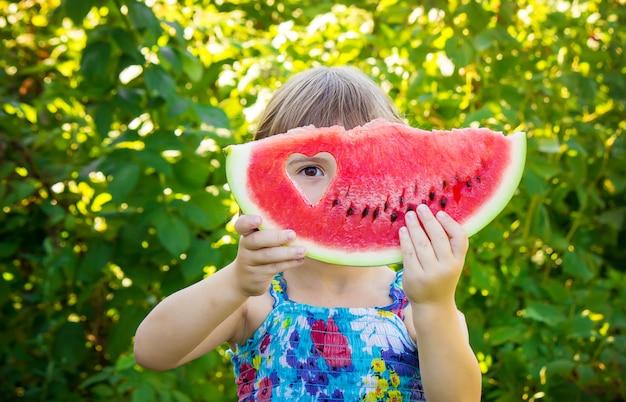 A child eats watermelon. selective focus. food Premium Photo