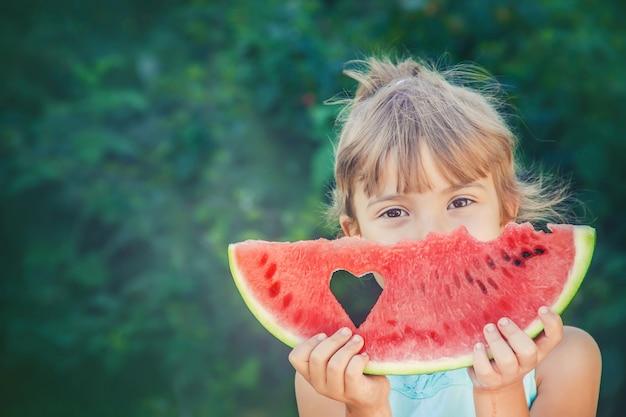 A child eats watermelon. Premium Photo