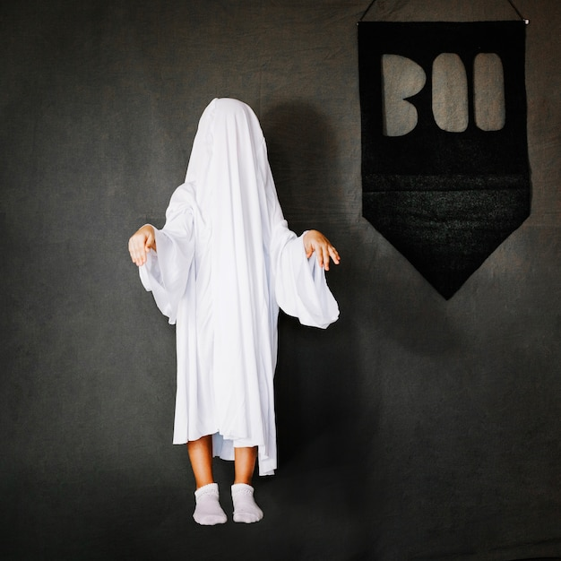 Child in ghost costume Free Photo