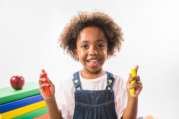 Child holding plasticine in studio Free Photo