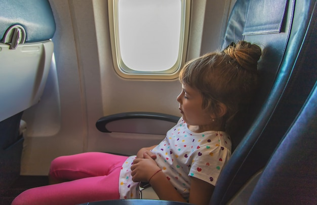 The child is sleeping on the plane Premium Photo