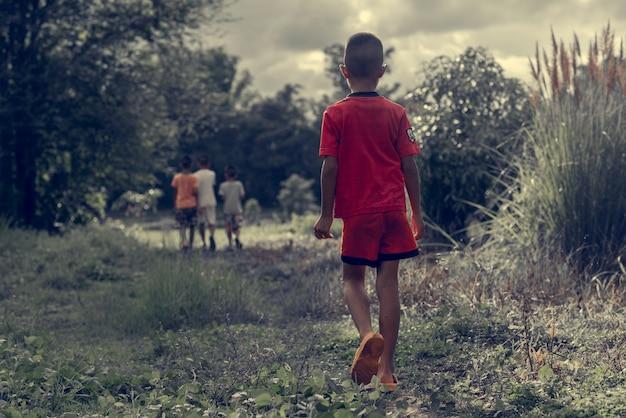 A child is walking in the dark woods Premium Photo