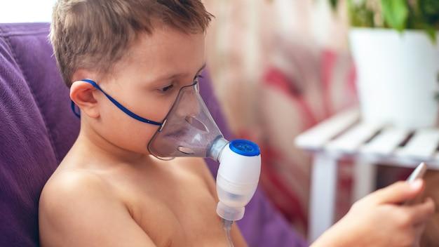 Child makes inhalation nebulizer at home Premium Photo