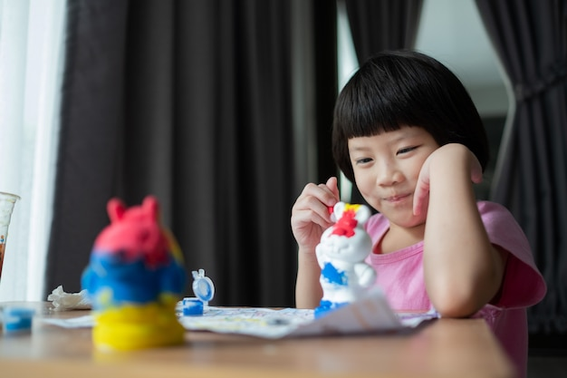 Child paint color on paper, education concept Premium Photo