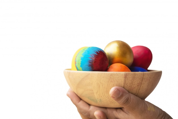 Child showing colorful easter eggs happily - easter holiday celebration concept Free Photo