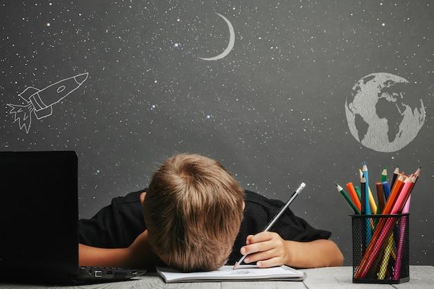 Child studies remotely at school Premium Photo