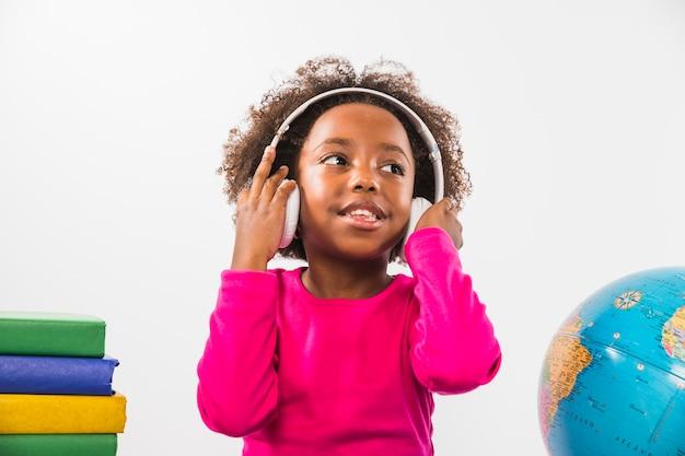 Child wearing headphones in studio Free Photo
