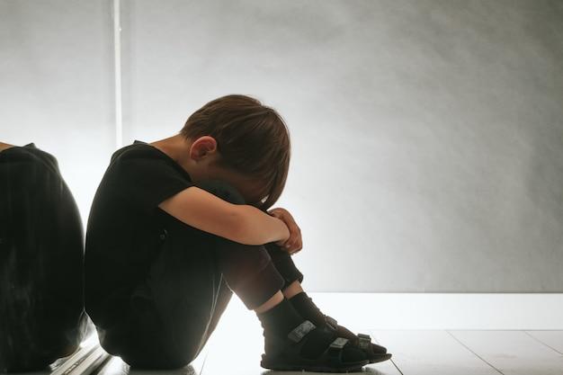 Child whose depression is sitting on the floor Premium Photo