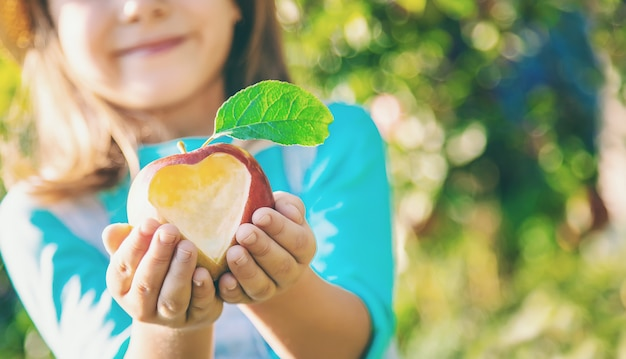 Child with child with an apple. selective focus. Premium Photo