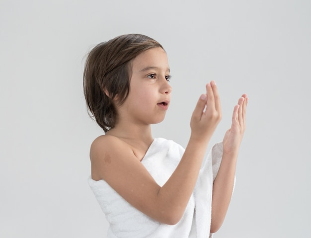 Child with hajj pilgrimage clothes praying Premium Photo