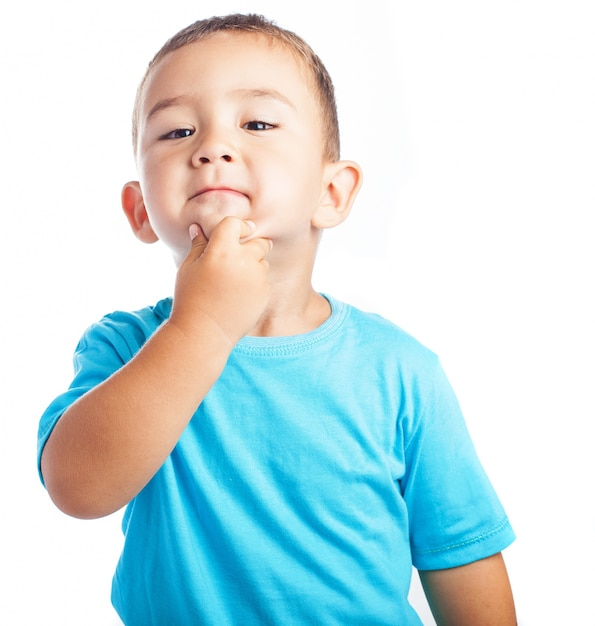 Child with hand on chin Free Photo