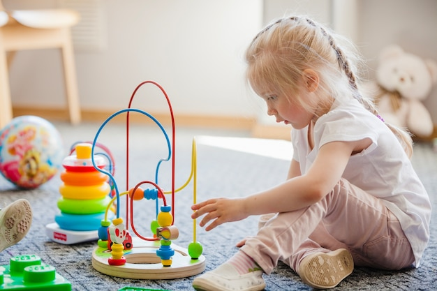 Child with plaything in room Free Photo