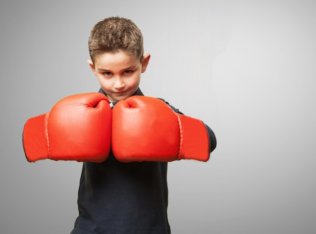 Child with red boxing gloves Free Photo