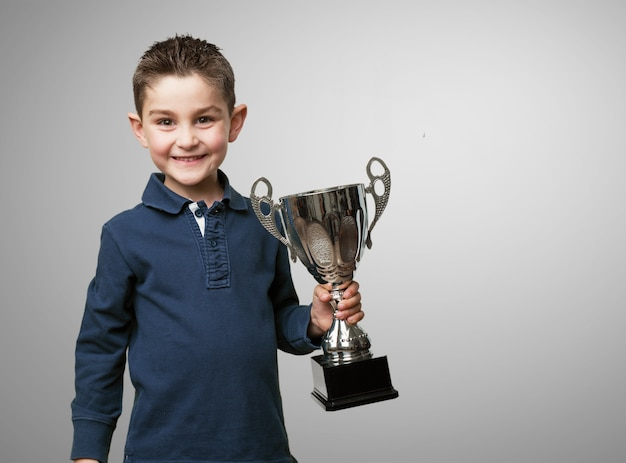 Child with a trophy Free Photo