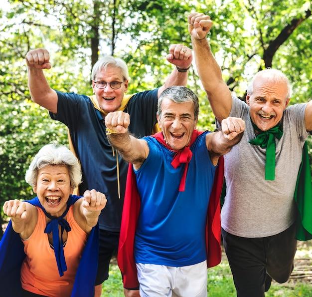 Childlike seniors wearing superhero costumes Premium Photo