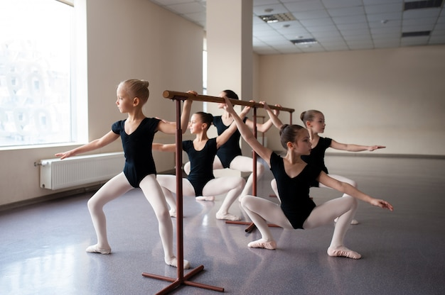 Children are taught ballet positions in choreography. Premium Photo