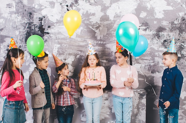 Children celebrating a birthday Free Photo